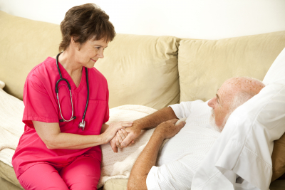 nurse holds the hand of senior man